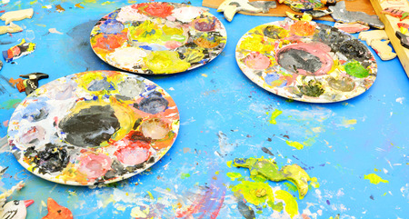 pallette: Used Painters Pallette, full of vibrant color of paints Stock Photo