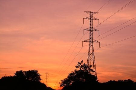 Power Pole. Electricity Pylons in the Setting Sun of Dusk photo
