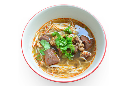 thai noodle soup: Thai vermicelli or boiled noodle eaten with curry and vegetable on white background with clipping path.