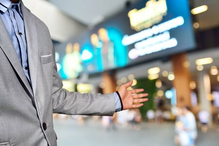 superstore: Business Man, Manager of Shopping Plaza or Mall, invite people to visit his Place as Retail Superstore or Department store service mind concept.