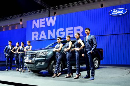 BANGKOK - March 26 : New Ford Ranger, Pick up truck, with male and Female presenters on DisPlay at 36th Bangkok International Motor Show on March 26, 2015 in Bangkok, Thailand.