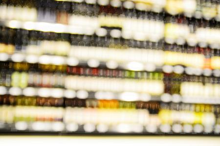 Blur or Defocus image of Wine on the Shelf of Liquor Store Stock Photo