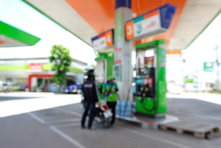 servicing: Blur or Defocus Background of Petrol Station while servicing a customer Stock Photo