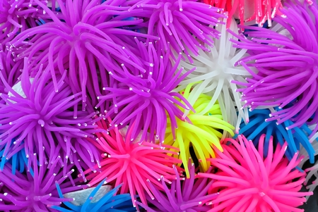 sea anemone: Background of Multicolor Rubber or Silicone Sea Anemone. These for Fish Tank Decoration. Stock Photo
