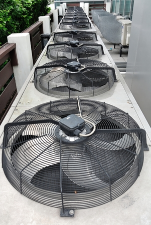 Row of Residential air conditioner compressor units in The Garden