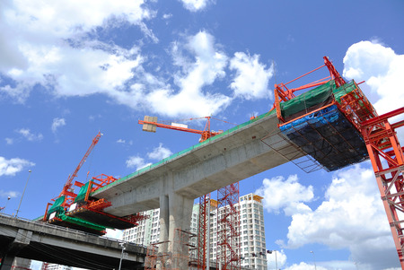 concrete construction: Construction site with Tower Crane and Blue Sky Stock Photo