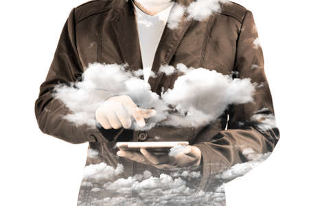 Double exposure of Business Man using Mobile Tablet PC with Cloud and Sky as Cloud Computing or Network concept. Stock Photo