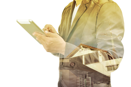 double click: Double exposure of Business Man and Building with Radio Antenna as Wireless Technology concept.  Focus Point on Right Index Finger or Trigger Finger. Stock Photo