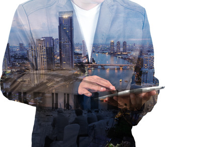 partnership: Double Exposure of BusinessMan and City with Business Meeting as Teamwork or Partnership Concept.