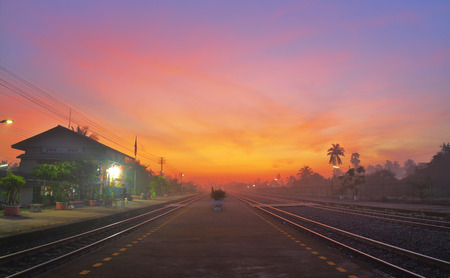 railway points: Railway or Train Station at Twilight time Stock Photo