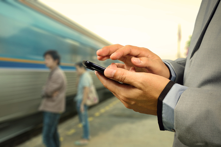 businessman waiting call: Business Man use Mobile Phone in Railway Station with Running Train
