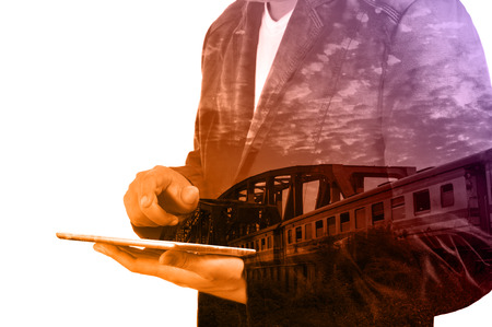 railway transportation: Double Exposure of Business Man use Tablet and Train over Railway Bridge as Transportation or Business Travel concept.