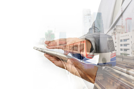railway: Double Exposure of Business Man and Skytrain or Subway as Modern City Transportation or Business Travel concept. Stock Photo