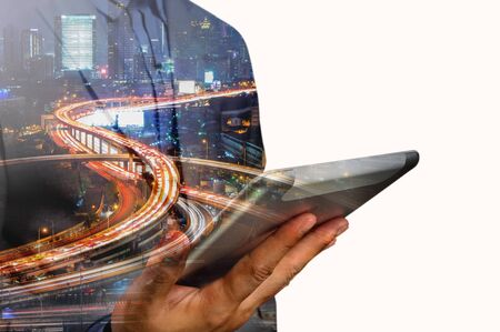 high speed internet: Double exposure of Business Man use Mobile Tablet with Urban City Scenic and HighWay as High Speed Internet or Wireless TeleCommunication