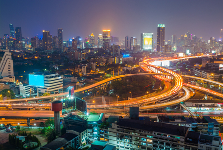 interchanged: Aerial view of Bangkok city downtown background, highway interchanged at Night