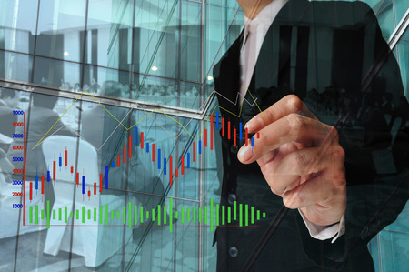chief executive officers: Double Exposure of Businessman draw Bar chart and Business Meeting or Seminar in Conference Hall as Economic Conference Stock Photo