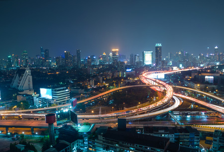 intersect: Aerial view of Bangkok city downtown background, highway interchanged at Night
