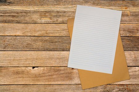 blank note: Blank Note Paper with Brown Envelope over Wood Blackground