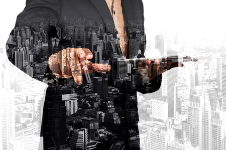 intelligent solutions: Businessman with Tablet and City of Bangkok, double exposure Stock Photo