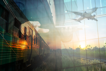 railway points: Double Exposure of BusinessMan Hold Tablet and Train, Airplane as Business Transportation or Logistics Concept. Selective Focus on Right hand.