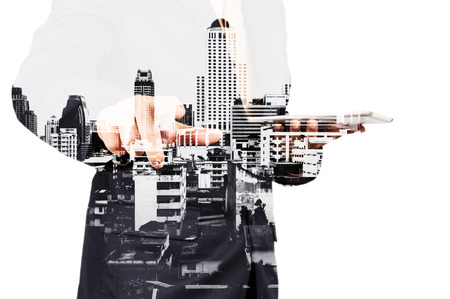 real leader: Businessman with Tablet and City of Bangkok, double exposure as Real Estate Development Concept