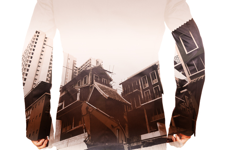 man power: Double exposure of Business Man and Power Crane in the City as Construction Project concept.
