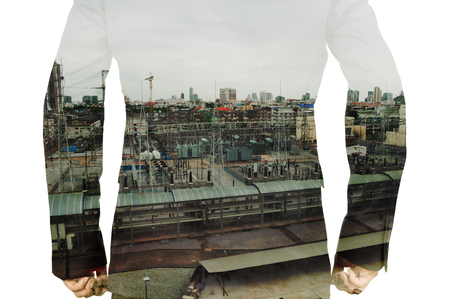 eletrical: Double Exposure of Businessman and Power Plant as Ecology or Energy Business Concept Stock Photo