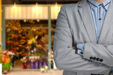 outoors: Businessman as Florist standing in front of Flower or Floral Shop, Small business owner or Entrepreneur Concept