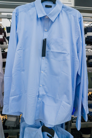 closet rod: Blur Shirt on Hanger in Supermarket or Hypermarket Outlet Store
