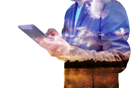 Close up of businessman with tablet with Cloud sky and Lake double exposure isolated on white Stock Photo