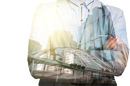 modern building: Double Exposure of Businessman and Business building City at Sunrise as Business Concept Stock Photo