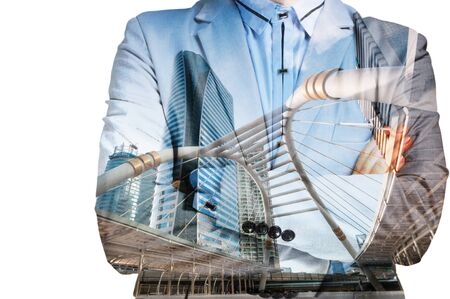 Double exposure of businessman in suit and cityscape. Hes looking for his success in business and idea for life. Stock Photo