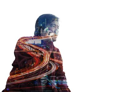 Adult Asian Man use Mobile phone with Expressway and Office building City, Double Exposure isolated on White Background with Copyspace. photo