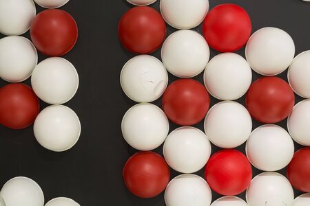 red sphere: Background of Red and White Sphere on Black Wall with Dramatic Lighting Stock Photo
