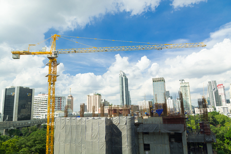 realestate: Construction Site with Tower Crane and Scenic Modern City Building
