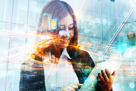 Double Exposure of Business Woman use Wireless Digital Mobile Tablet with Expressway or Highway in Modern city with Bokeh as Business Technology Telecommunication Concept.