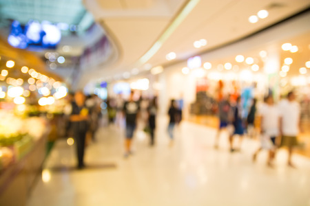 retail shopping: Abstract Blur or Defocus Background of People or Crowd shopping in Department Store or Retail shopping mall Modern Building in City   Stock Photo