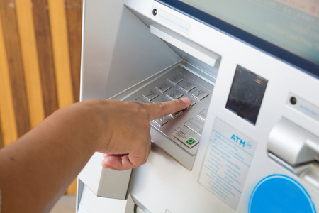 Keyboard Panel of ATM or Autmatic Teller Machine with Female Hand Push ATM Security Pin Code or Password to make Transaction as Modern Financial Technology Security Concept. Stock Photo