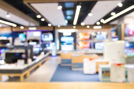 Fondo abstracto de la falta de definición de la tienda del aparato electrodoméstico, del departamento de la TV o de la televisión