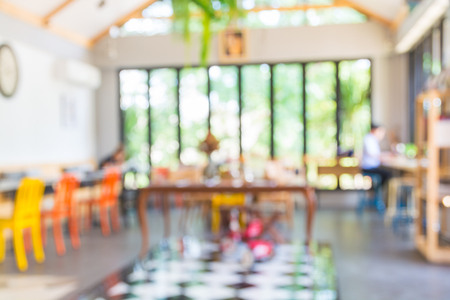 Abstract Blur Background of People woking in Cafeteria or Coffeeshop Co-working space as Modern Freelance Lifestyle Concept.
