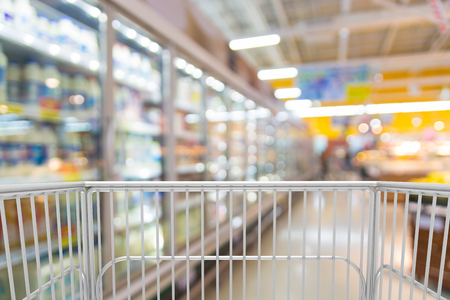 Trolley Shopping Cart in Hypermarket or Discount Convenience Store outlet at Frozen Food and Cold Drink Beverages Section as Modern Urban Lifestyle Concept