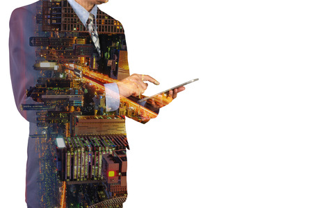 Double Exposure of Businessman Hold Digital Tablet and Modern Capital City of Bangkok at Twilight with Expressway or Superhighway as Smart City Lifestyle concept