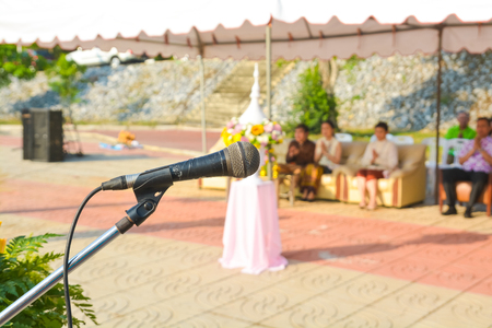 Close up of Microphone over the Podium in Meeting , Wedding Outdoor Event as Professional Communication Speech in Public or Press Conference concept