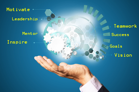 Hand of Businessman hold Gear or Cogwheels of Business Finance Strategy as Technology Innovation Concept showing Motivate, Leadership, Mentor, Inspire, Teamwork, Success, Goals, and Vision for Working as Team. Zdjęcie Seryjne