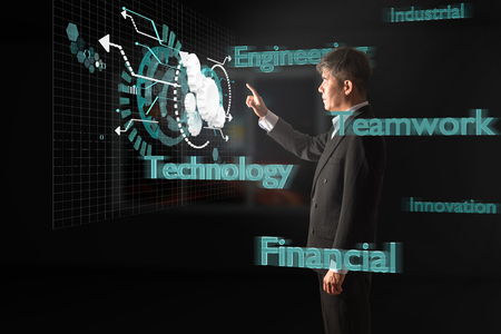 Businessman touch Virtual digital display of Cogwheel in Dark room with Business Technology Concept of Innovation, Engineering, Teamwork, Industrial and Financial