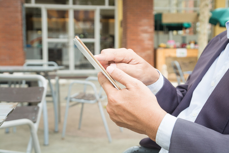 Asian Businessman in Suit use Digital Wireless Tablet outdoor in Public with Wifi connection as Modern Business and Technology Lifestyle Zdjęcie Seryjne