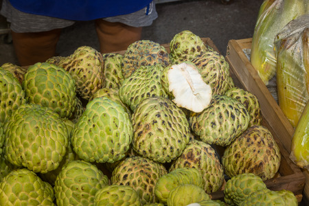 Pile or Stack or Custard Apple, Sugar-apple, natural Tropical America Sweet and Soft flesh Fruit in Basket. Standard-Bild