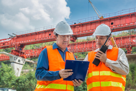 Engineer or Architect consult over Radio Communication to supervise or manage Motorway or Highway Project Development as Construction industrial concept.
