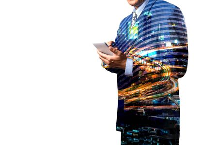 Double Exposure of Businessman hold Digital smart Tablet or Smartphone with Modern City Traffic scene as Business Technology Concept.