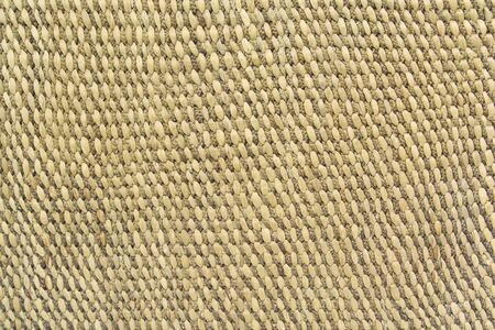 Close up detail view of a wicker basket weave as Background or Pattern of Bamboo or Straw weaving Standard-Bild